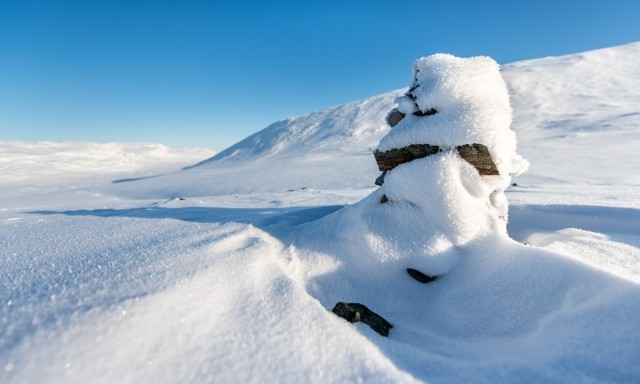 Snow covered Cairn in Swedish Lapland